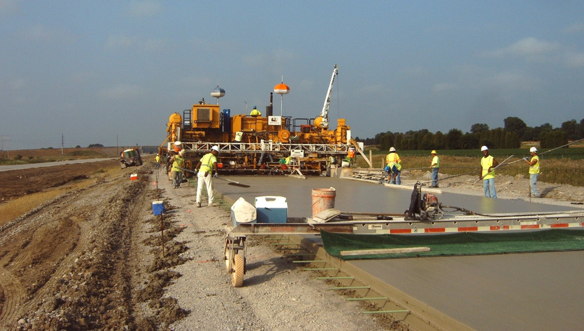 Workers spreading concrete